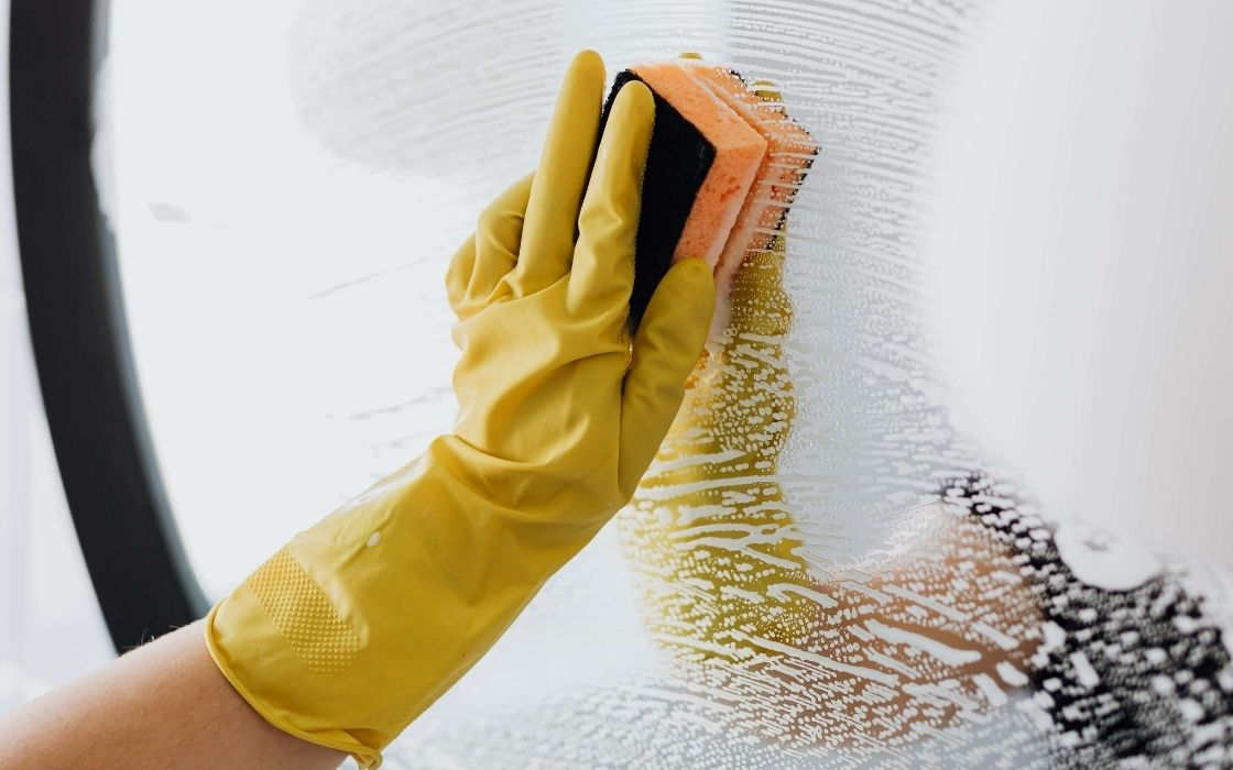 wiping mirror with rubber gloves